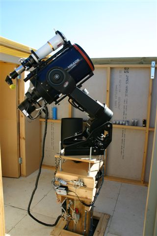 Photo of the telescope fully setup up on a wooden pier